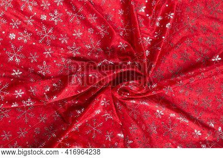 Colored Red Textile Satin Fabric Folded In Folds And Waves With Highlights And Texture Shimmers In T