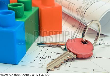 Polish Currency Money And Building Blocks On Electrical Construction Drawing Of House. Concept Of Bu
