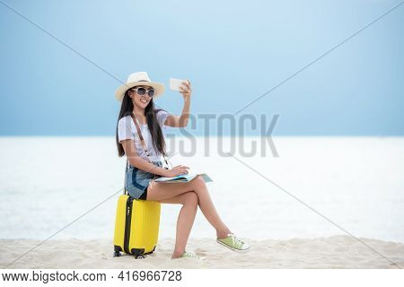 Happy Traveler And Tourism Young Women Travel Summer On The Beach. Asian Smiling People Holding Sma