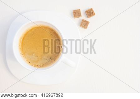 Cup Of Coffee On Saucer With Three Sugar Cubes Isolated On White Background And Copy Space For Text