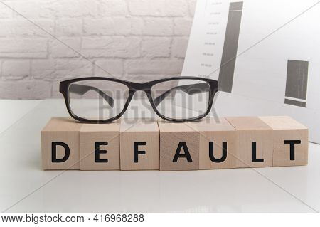 The Word Default Is Written On Wooden Cubes Standing On The White Surface Of The Table, The Glasses