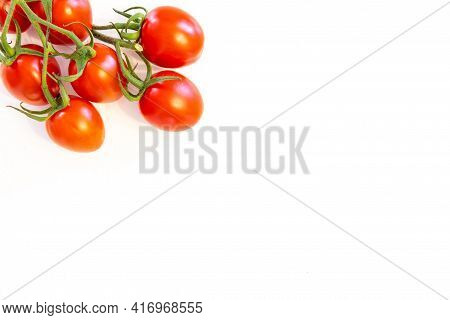 Branch Of Fresh Cherry Tomatoes Isolated On White Background With Copy Text On Right Bottom