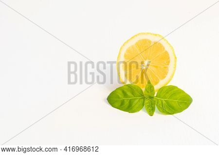 Half Yellow Lemon Fruit Isolated On White Background With Leaf And Copy Space