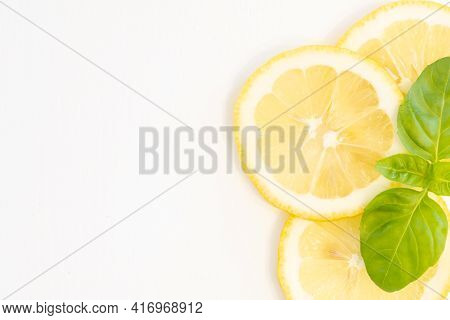 Lemon Slices With Green Leaf Isolated On White Background And Copy Space For Text On Left Side