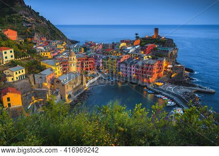 Beautiful Vernazza Village View From The Flowery Garden With Colorful Houses And Small Harbor At Sun