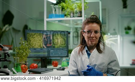 Pov Of Chemist Woman In White Coat Analyzing With Biologists Team