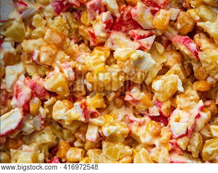 Vegetable Salad With Corn And Crab Sticks In Mayonnaise. Yellow Corn. Crab Meat. Seasoning Sauce May