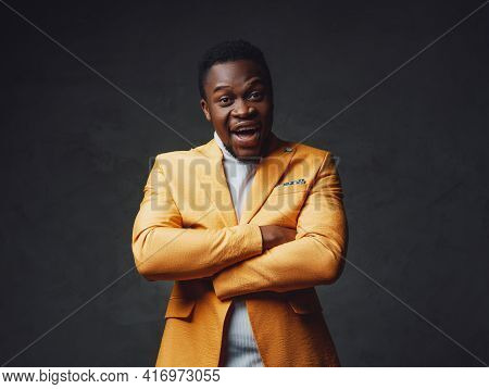 African Descent Businessperson Dressed In Yellow Coat