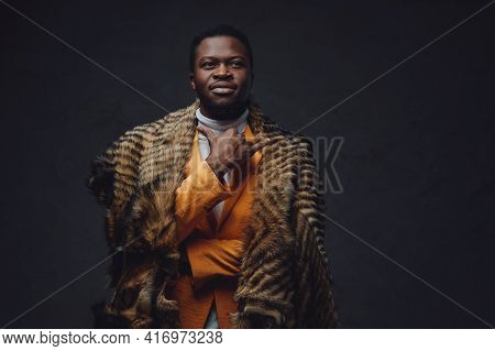 Pensive African Hipster Dressed In Classy Clothing