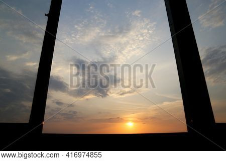 View Through Open Window To Sunset On Colorful Sky, Clouds In The Pink And Orange Sunlight. Pictures