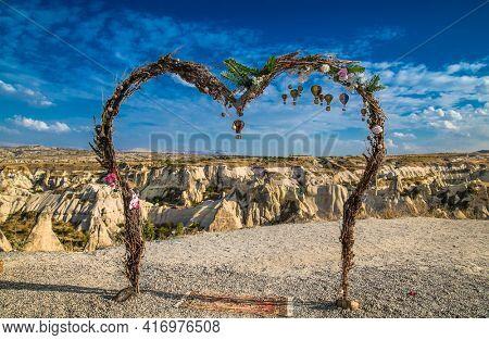 Cappadocia, Turkey - Oct 22, 2020: High heart observation deck looking on strange landscape with amazing rocks in Love Valley in Cappadocia, Goreme, Turkey.