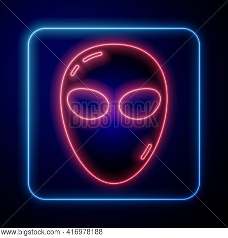 Glowing Neon Alien Icon Isolated On Blue Background. Extraterrestrial Alien Face Or Head Symbol. Vec