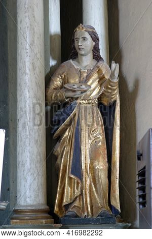 SLAVETIC, CROATIA - JULY 22, 2013: St. Lucia, statue on the altar of St. Barbara in the parish church of St. Anthony the Hermit in Slavetic, Croatia