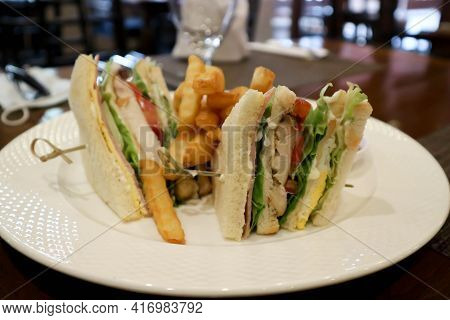 Chicken And Ham Sandwich, Club Sandwich With French Fries And Ketchup