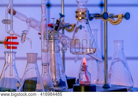 Laboratory equipment in a chemical laboratory. Laboratory setup for chemical synthesis of organic matter