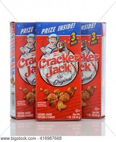 IRVINE, CALIFORNIA - MAY 23, 2019:  Three boxes of Cracker Jack. The brand registered in 1896, is a snack consisting of molasses flavored, candy coated, popcorn and peanuts.