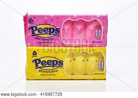 IRVINE, CALIFORNIA - 20 APRIL 2020: Two Packages of Peeps Marshmallow Chicks for Easter, Yellow and Pink Varieties.