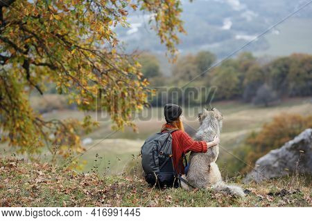 Woman Hiker With Dog In Nature Admire The Mountains Travel