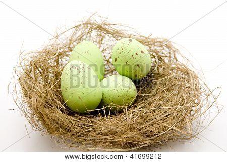 Green Eastereggs in Easter Basket