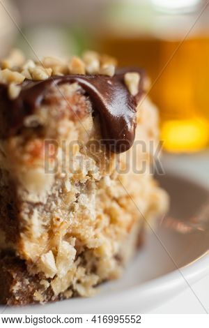 Appetizing Chocolate Cake. Drops Of Chocolate Drip Down The Side Of The Cake. Detail Of A Cream Cake