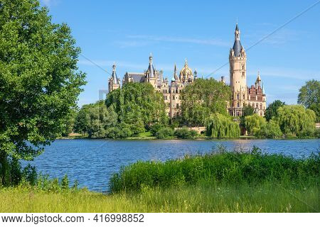 Schwerin Castle Or Palace (schweriner Schloss)  Situated On An Island In The City's Main Lake, Lake
