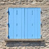 Close up of a traditional old blue painted wooden door in Provence France Europe. Pattern texture background. poster