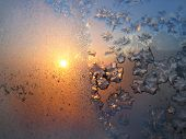 Beautiful ice pattern and sunlight on winter glass poster