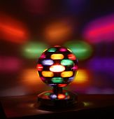 Colorful disco lights ball rotating reflections on wall poster