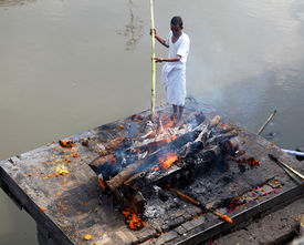 KATMANDU NEPAL - NOVEMBER 7: Nepalese people burning corpses and then drown them in a river.