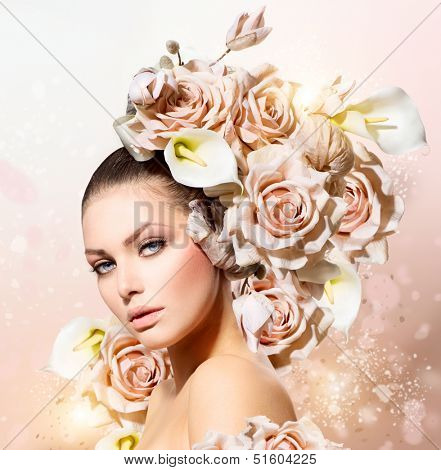 Fashion Beauty Model Girl with Flowers Hair. Bride. Perfect Creative Make up and Hair Style. Hairstyle. Bouquet of Beautiful Flowers