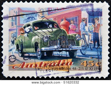 A Stamp printed in Australia dedicated to classic cars shows the GMH Holden 48-215 (FX)