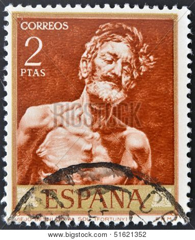 stamp printed in Spain shows painting of Old Man in the Sun by fortuny