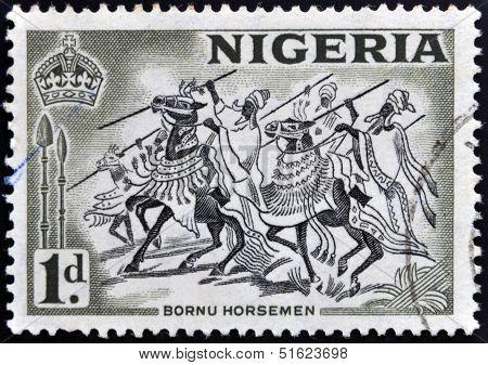 A stamp printed in Nigeria shows image of Bornu horsemen
