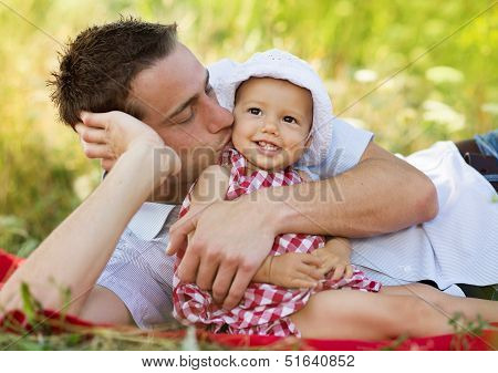 Happy young father spending time outdoor on a summer day with his beautiful daughter poster