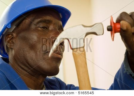 Construciton Worker With Hammer In Motion