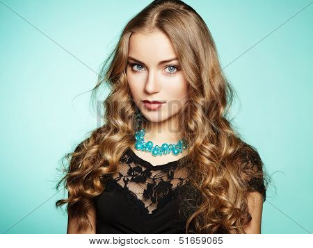 Portrait Of Beautiful Young Blonde Girl In Black Dress