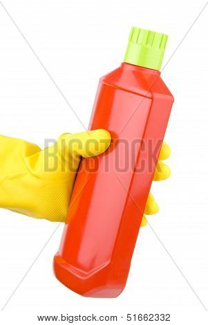 Hand With Yellow Glove Holding Bottle Of Detergent