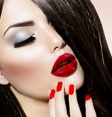 Beauty Girl with Red Lips and Nails. Provocative Makeup. Luxury Woman with Long Brown Smooth Hair. Fashion Brunette Portrait. Gorgeous Woman Face. Perfect Make up  poster