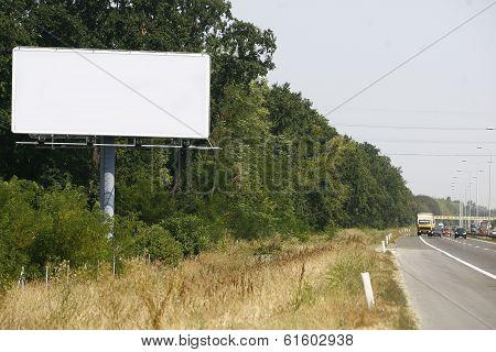 Empty Billboard On Background Of Sunset Sky