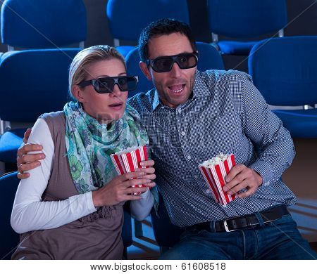 Couple Reacting To A 3D Movie