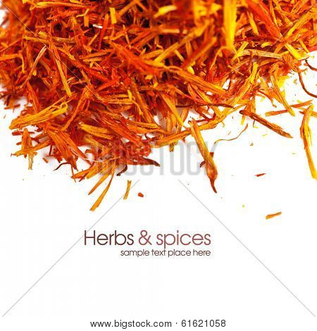 Saffron treads in pile, isolated on white, shallow dof