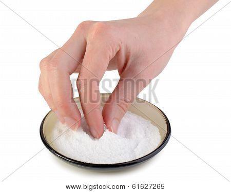 Female Hand Taking Salt