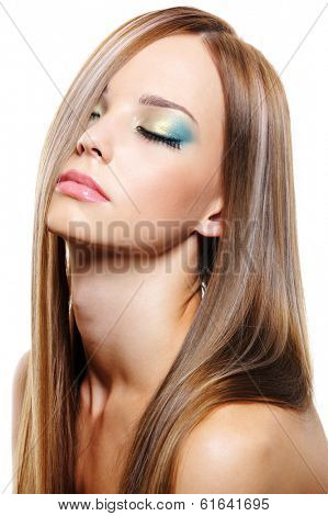 Sensitive expressive portrait of young beautiful pretty woman with healthy long blond hair