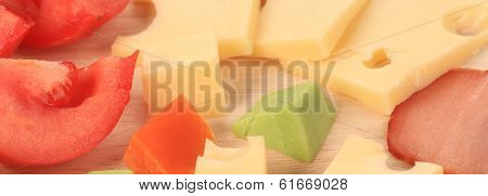 Close up of varoius cheese and tomatoes.