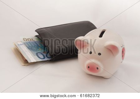Black Leather Bi-Fold Wallet and a Piggy Bank on a White Background