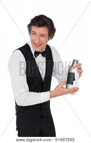 Happy bartender using cocktail shaker isolated over white background
