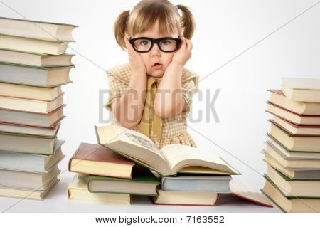 Little Girl With Books Wearing Black Glasses