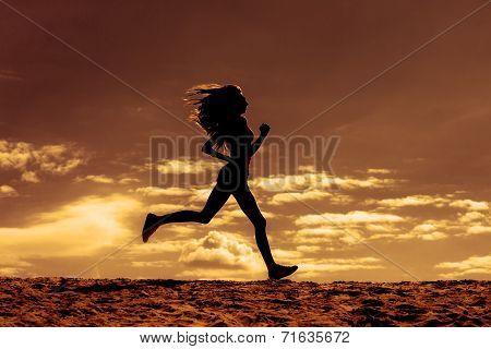 Silhouette of a girl runner effect films
