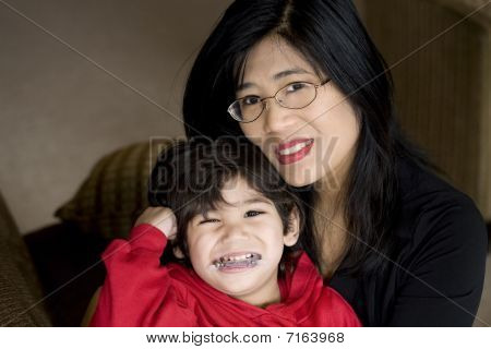 Mother Holding Disabled Son