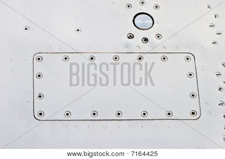 Metallic removable cover plate screwed to aluminum background poster